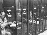 Unemployed Executive Making Appointments for Interviews from Telephone Booth
