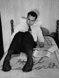 Vice Presidential Candidate Richard M Nixon Sitting on His Hotel Bed Reviewing Paperwork