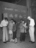 Peddlers at Gate to Shanghai Selling Curios to Two American Sailors