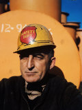 Worker Wearing Safety Helmet Outside at Sun Shipbuilding and Dry Dock Co Shipyards