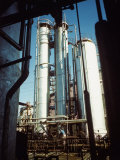Pipes and Columns Dwarfing Worker at the Union Oil Co Refinery Built by Bechtel- Mccone-Parsons