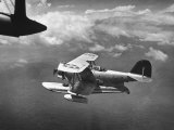 J2F Utility Plane Flying over Pacific Ocean
