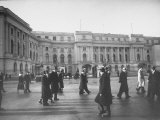 Pedestrians Hustling Past in Front of Main Entrance to the Royal Palace Where King Carol II Resides