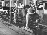 Women Washing Off the New Assemble Vehicles at the Fiat Auto Factory