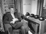 Manager of the Associated Press Kent Cooper  Sitting Beside Four Telephones in His Office