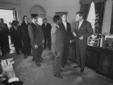 President John F Kennedy and R Sargent Shriver Greeting People at White House