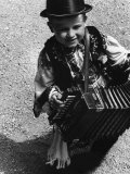 Young Mezokovesd Citizen  Carrying an Accordian