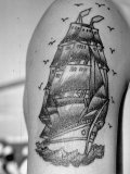 Tattoo of a Ship Being Displayed on Arm of a Us Sailor