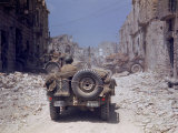 American Jeeps Travelling Through Completely Bombed Out Town During the Drive Towards Rome  Wii