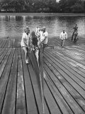 Sen Leverett Saltonstall  Helping His Crew Members Carry the Canoe on Deck at Harvard