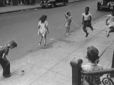 Children Jumping Rope on Sidewalk