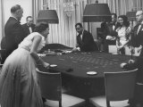 People Gambling at the Tables