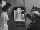 Doctors Examining X-Ray with Nurse