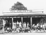 School Children Waiting for the Bus at the General Store