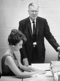 Inventor Chest Carlson Standing Next to Woman Using Dry Copying Process That He Invented