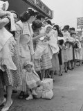 "Mothers Waiting in Line with their Babies Outside the ""Queen for a Day"" Program"