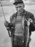 Fisherman Lauri Rapala  Who Handmakes Fishing Lures  with a Fish He Caught