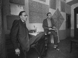Painter Brion Gysin  Shown W His Paintings in Hotel Room in with Writer William S Burroughs