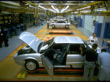 """Workers Manning """"Skillet"""" Equipped Saturn Assembly Line at Saturn Plant"""