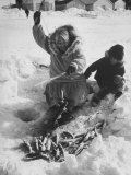 Eskimo Woman Showing Grandson How to Fish Through the Ice