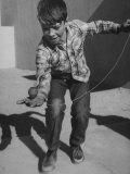 Little Boy Demonstrating a Top