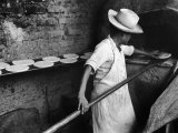 Communal Bakery in Primitive Mexican Village  Loaves of Bread Being Shoved into Adobe Oven