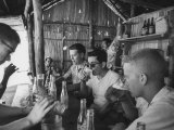 Volunteers Drinking in Thatched Shack