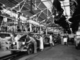 Men and Women Polishing Chevrolets on the Assembly Line at the General Motors Plant