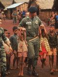 American Advisor  Captain Vernon Gillespie Jr   Playing W Local Children