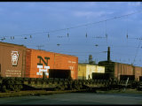 Line of Railroad Box Cars Lit by Late Day Sun