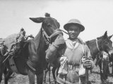 Gurkha Member of the 4th Indian Division of the British 8th Army Petting a Pack Mule