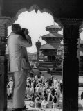 Tourist in Nepal Taking a Picture of a Temple