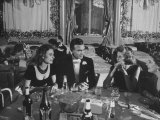 Porfirio Rubirosa and Wife Having Dinner with Friends