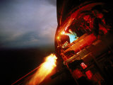 Crew of Us Ac-47 Plane Firing 762 Mm Ge Miniguns During Night Mission in Vietnam