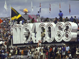 People Climbing and Sitting on a Mexico &#39;68 Sign at the Summer Olympics