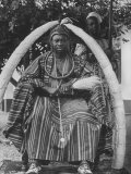 Yoruba Tribal Ruler in West Nigeria on Throne Surrounded by Elephant Tusks