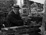 Winston Churchill Building a Brick Doll House for His Youngest Daughter