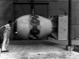 Workman Standing Next to Atomic Bomb Number 2  Nicknamed Fat Man  Hours before its Deployment