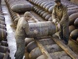 Pair of American Servicemen Moving a Large Bomb at an Ammunition Dump During WWII