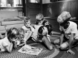 Apollo 8 Astronaut William Anders Reading Newsppaer Comics with His Children at Home