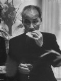 Indo Chinese Communist Leader Ho Chi Minh Eating at a Reception During His Official Visit to Poland