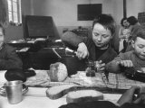 School Children in Classroom Eating Hot Food  Hard Bread  Cider