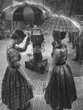 "Models Demonstrating Umbrellas under Artificial Rain on TV Program ""Home"""