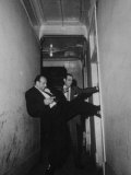 Chicago Detectives Forcing their Way in the Door of Suspicious Room