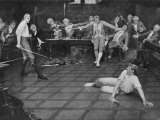 Men Duel W Swords in a British Meeting House