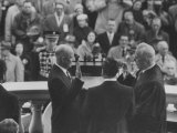 Pres Dwight D Eisenhower  Taking the Oath of Offace as it Is Given to Him by Earl Warren