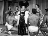 Entertainer Mae West Making Her Nightclub Debut with Loin-Clothed Dancers at Hotel Sahara