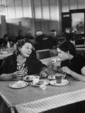 Woman and Her Daughter Eating in a Restaurant