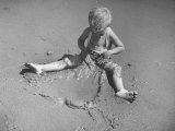 Little Boy Playing on the Beach at Ebb Tide