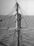 Man Standing in Crow&#39;s Nest of a Ship
